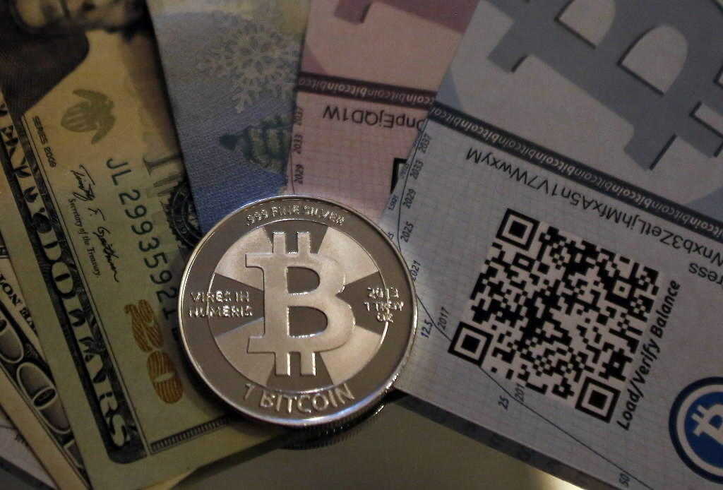 A mock bitcoin is shown in this photo illustration from 2013.