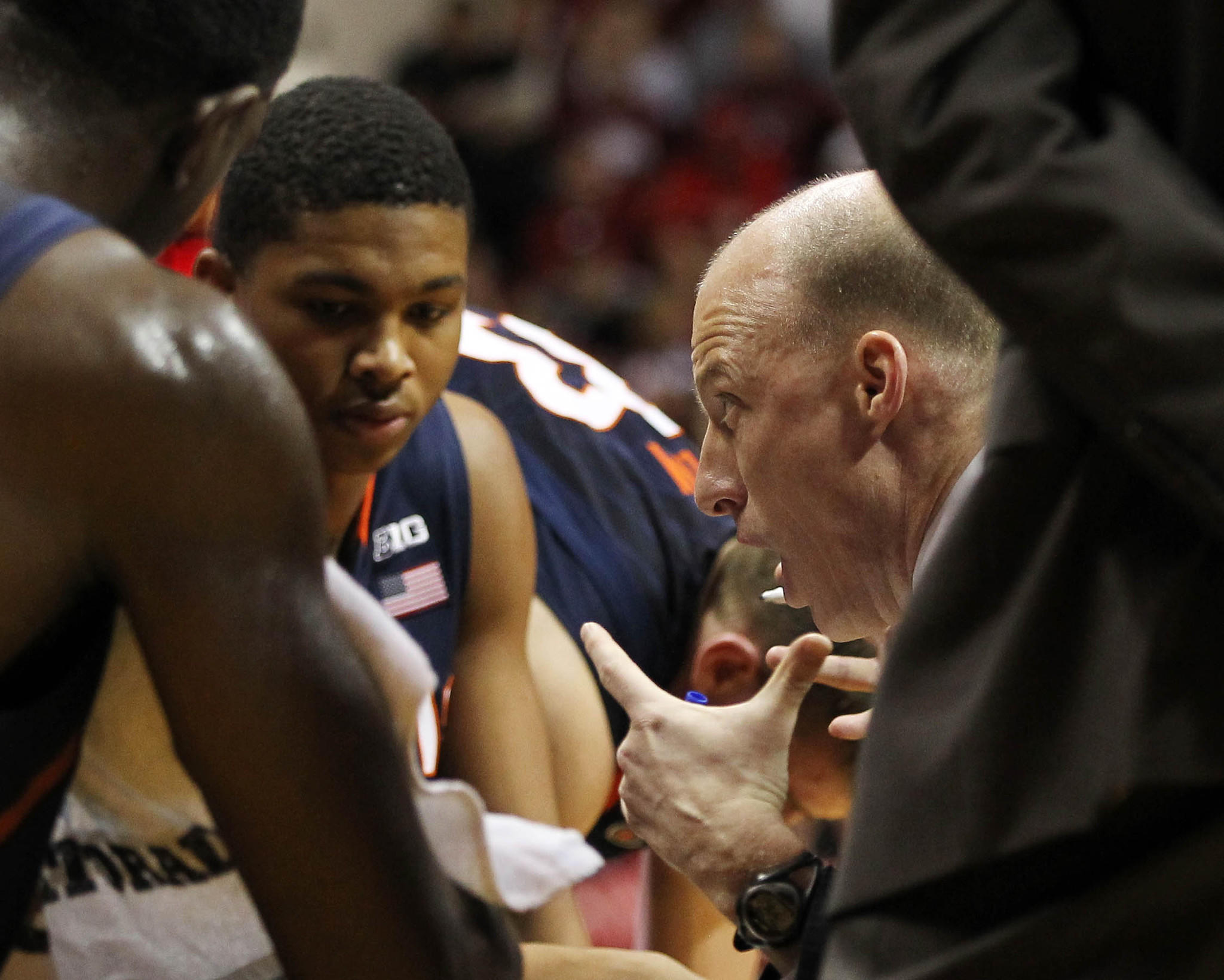 Illini coach John Groce talks with his team during a timeout during the second half.