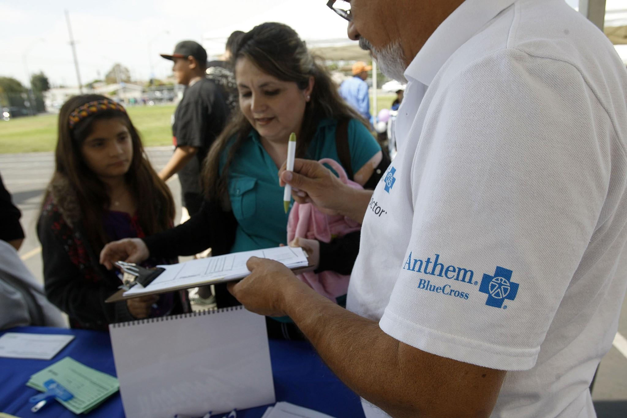 Anthem Blue Cross said its plan to raise rates reflects that escalating healthcare costs are a reality industrywide. Above, the Anthem booth at a health fair in East Los Angeles.