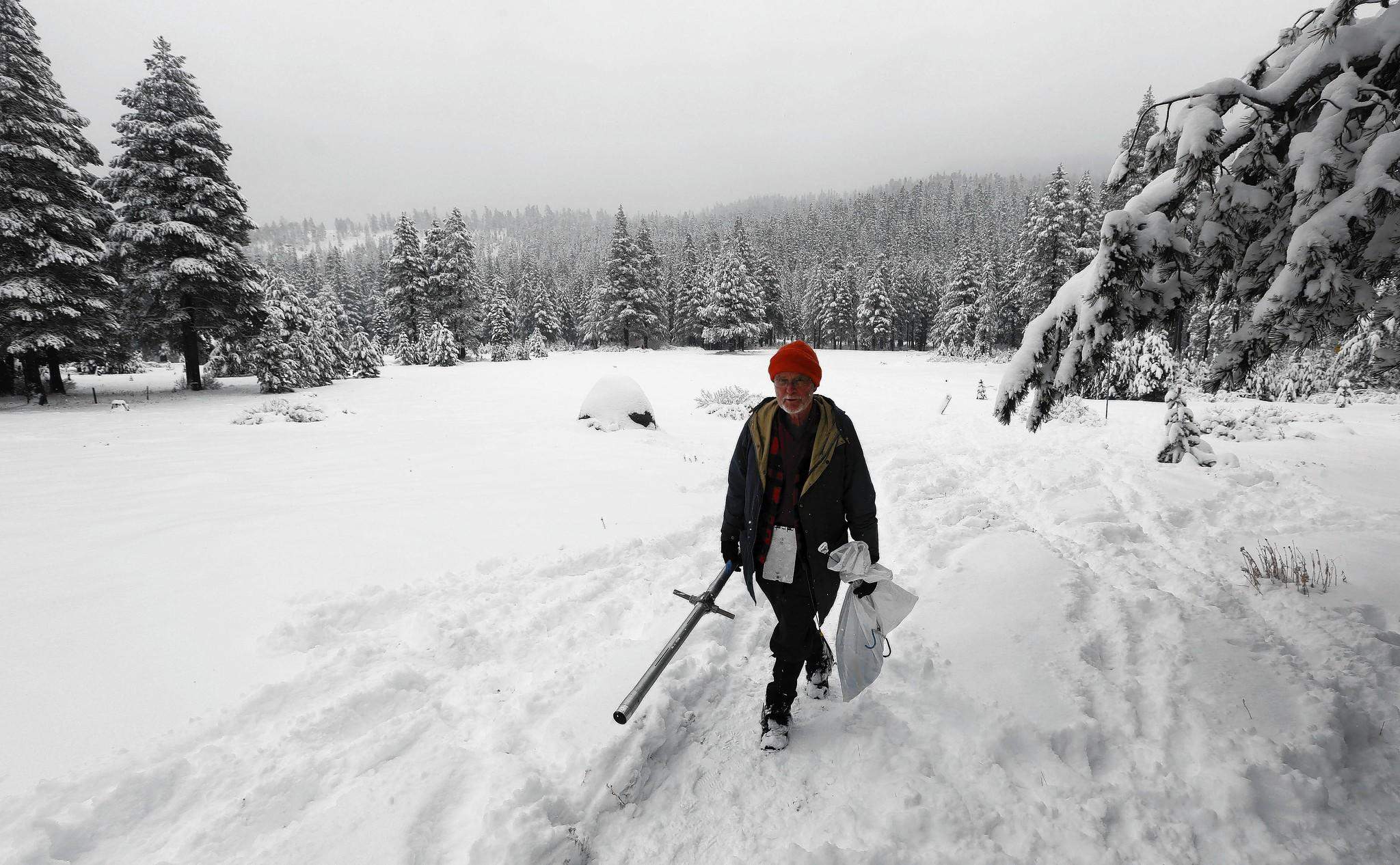 Frank Gehrke, chief of the California Cooperative Snow Survey Program for the Department of Water Resources, leaves a snow-covered meadow after the second snow survey of the year near Echo Summit, Calif. Gehrke said that while recent snow fall will help bolster the depleted snowpack, it is not enough to affect the water supply.