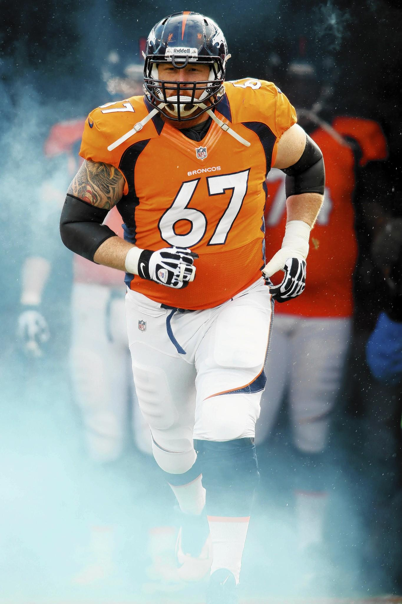 Jan 12, 2013; Denver, CO, USA; Denver Broncos center Dan Koppen (67) enters the field before the first quarter of the AFC divisional round playoff game against the Baltimore Ravens at Sports Authority Field.