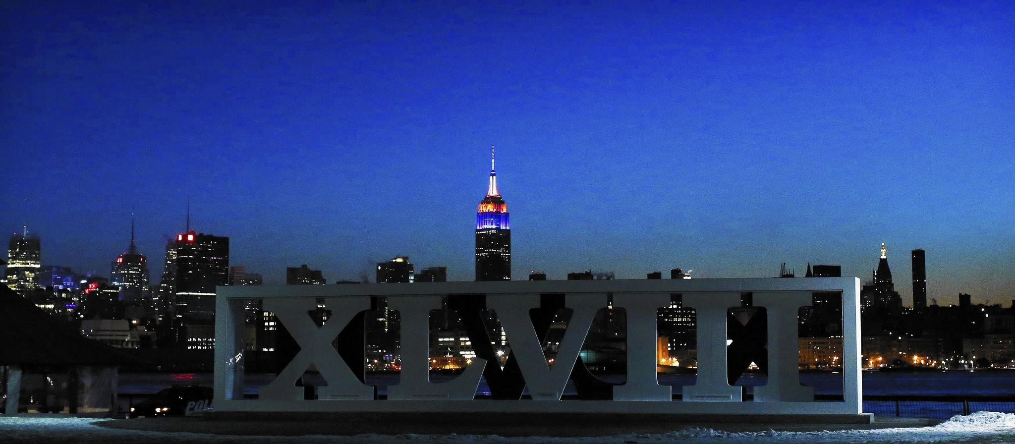 The New York skyline and the Empire State Building are seen in the distance as roman numerals for NFL Super Bowl XLVIII football game are displayed in Hoboken, New Jersey