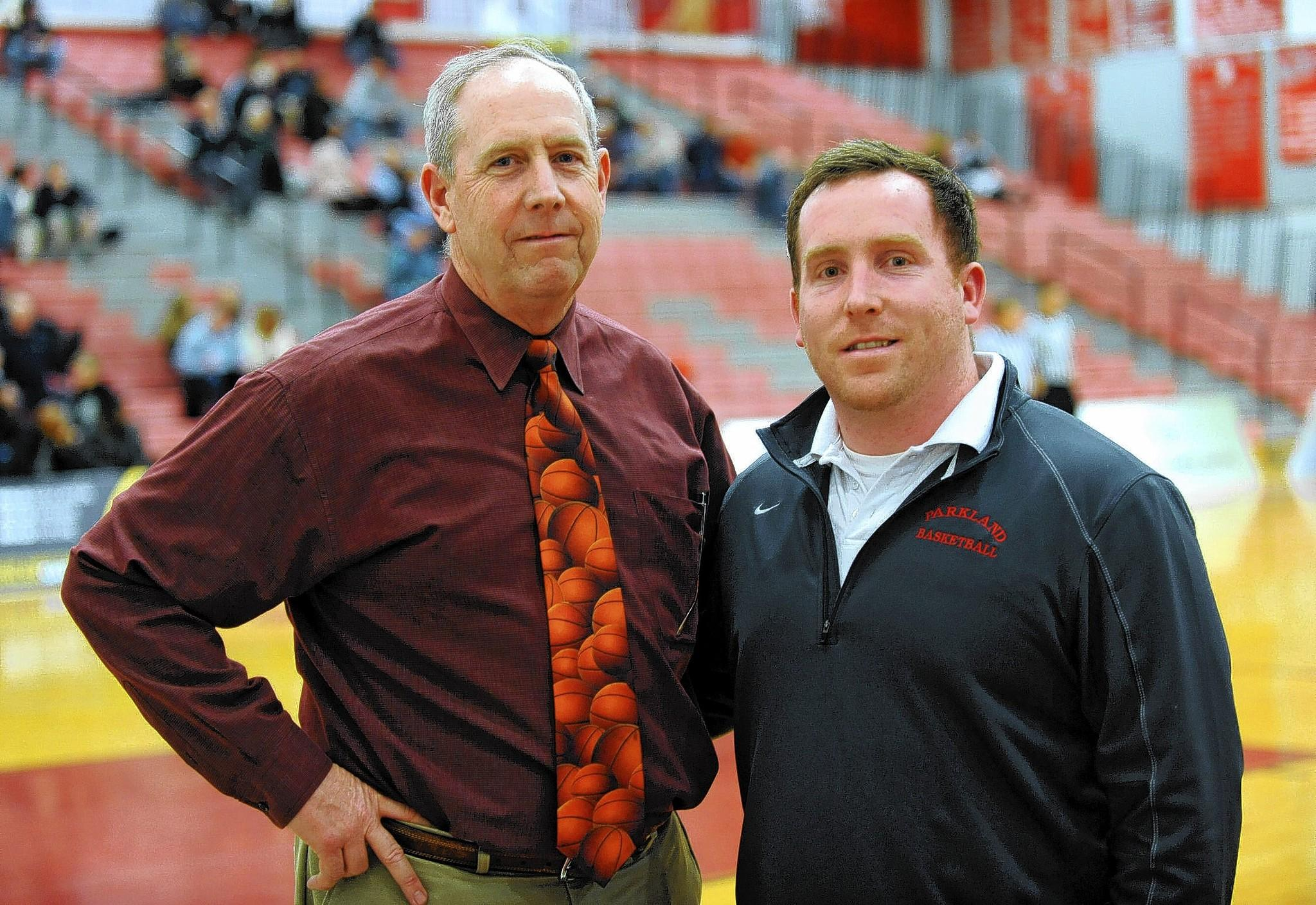 Bethlehem Catholic's assistant coach Ed Ohlson poses with his son Parkland's assistant coach Eddie Ohlson during half time. The Parkland boys basketball team played Bethlehem Catholic at Parkland High School Wednesday night.