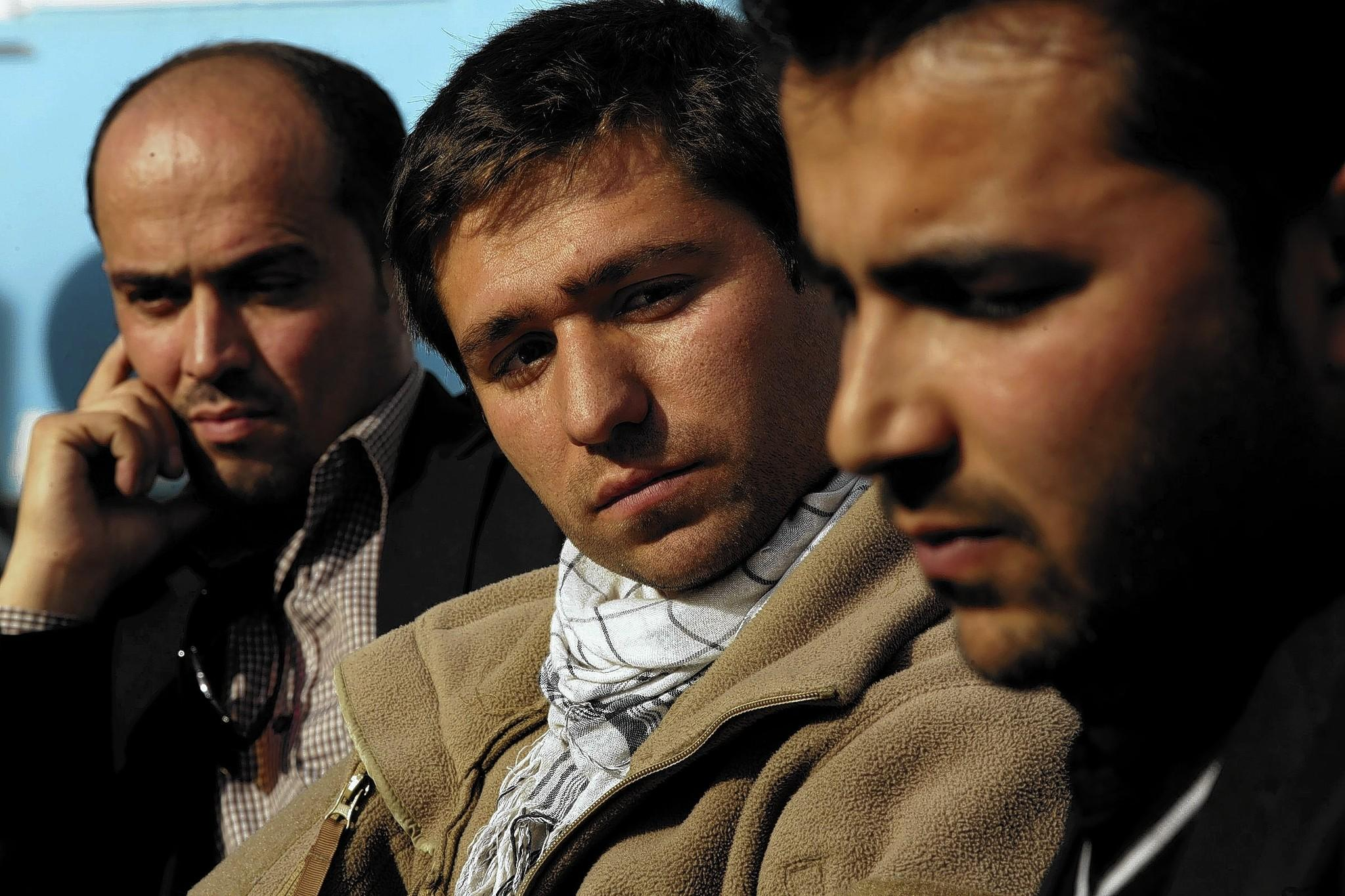 Shafiq Nazari, from left, Shirullah Mirzamalik, and Sardar Khan are among the Afghans who have applied to immigrate to the United States because their work as interpreters for the U.S. military has left them vulnerable to militant retaliation.
