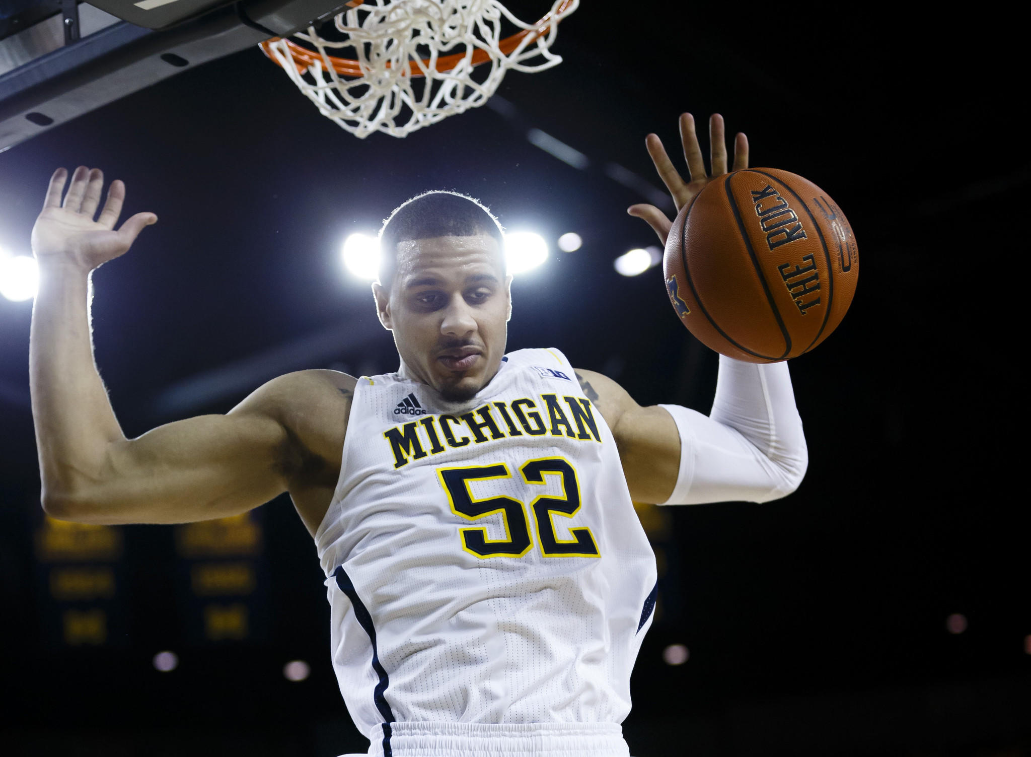 Michigan's Jordan Morgan dunks in the first half against Purdue.