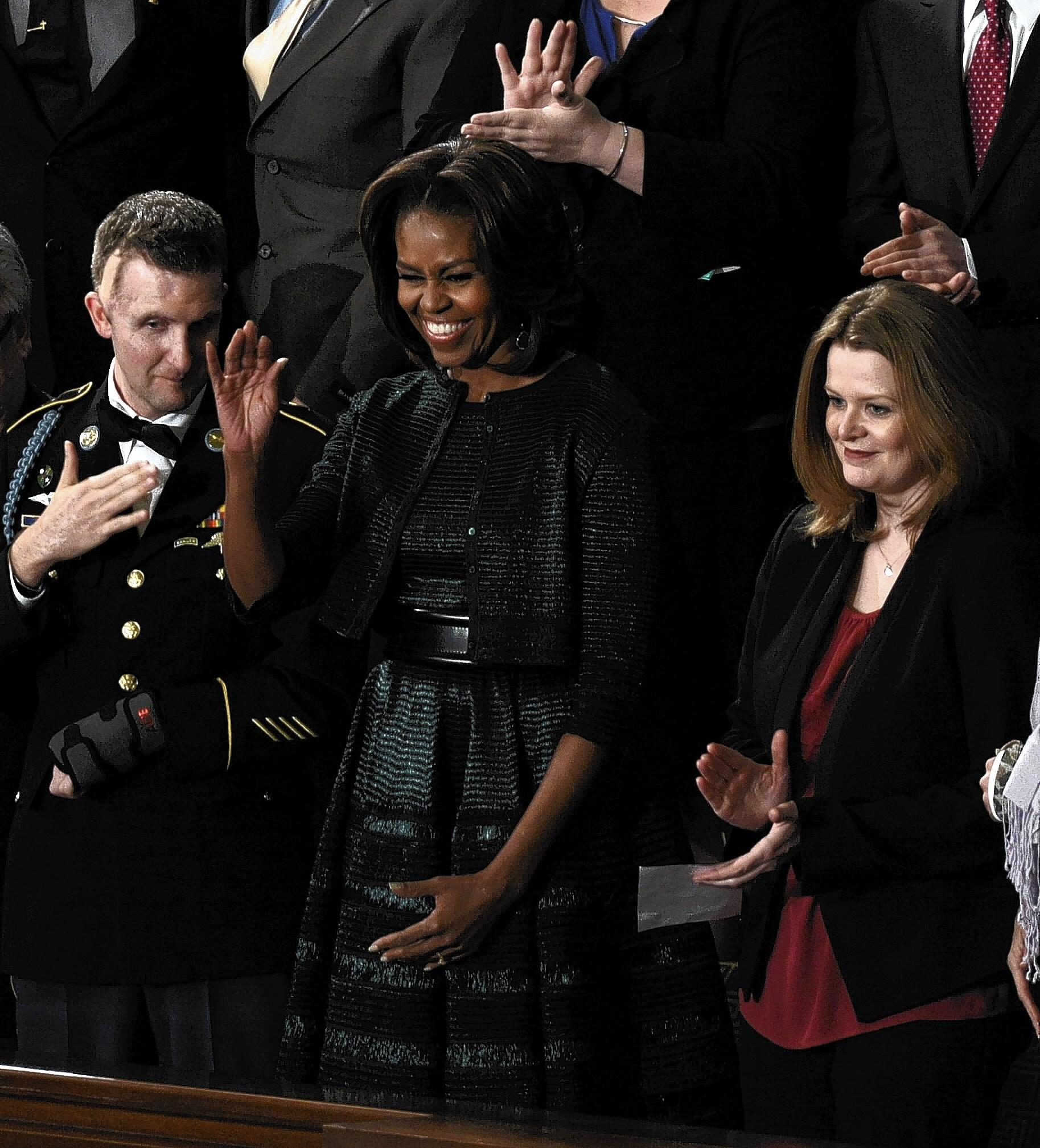 Misty DeMars, right, stands with first lady Michelle Obama before President Barack Obama's State of the Union address Tuesday. At left is Army Ranger 2nd Lt. Cory Remsburg.