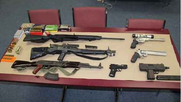 A photo distributed by Harvey police said to show the guns and ammunition found during a home search on Thursday.
