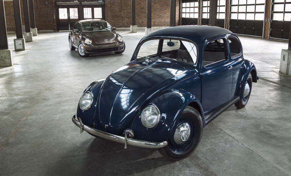 1949 Volkswagen Type 1 Beetle and a 2014 Beetle
