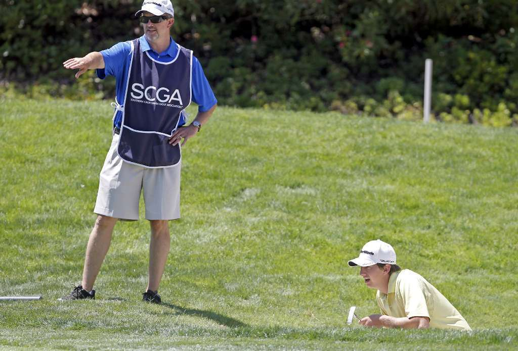 Ryan Knapp, right, of Costa Mesa is advised by his caddie, and father, Bob Knapp at the 113th SCGA Amateur Championship at Big Canyon Country Club in 2012. Knapp's last day as Costa Mesa's recreation manager is Friday.