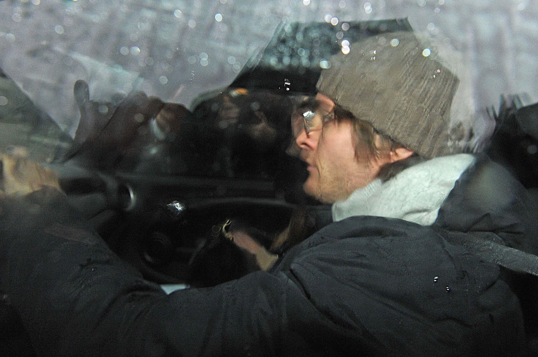 Amanda Knox's ex-boyfriend, Raffaele Sollecito, leaves police headquarters in the Italian city of Udine on Friday. A court in Florence ordered Sollecito to turn in his passport.