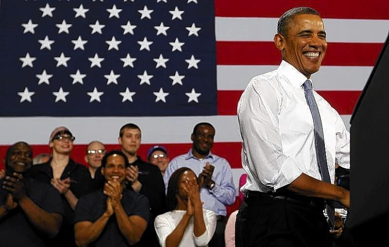 President Obama smiles before he addresses employees of General Electric's Waukesha Gas Engines facility in Wisconsin