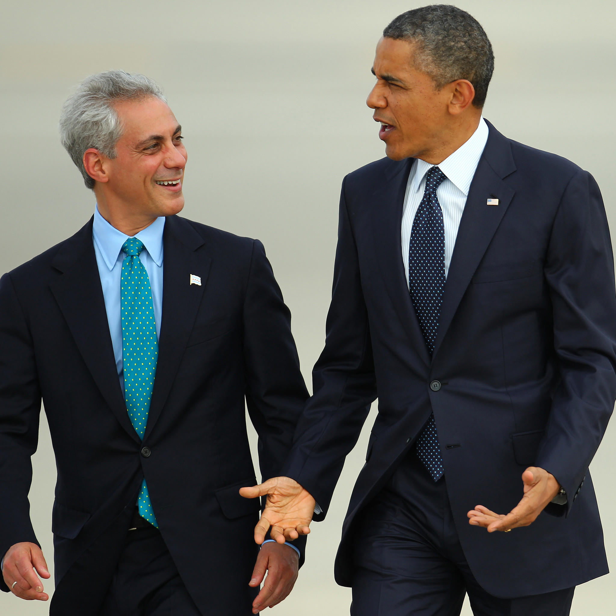 President Barack Obama walks with Mayor Rahm Emanuel, his first White House chief of staff, as he moves from Air Force One to Marine One shortly after landing in town for a pair of Democratic fundraisers Wednesday, May 29, 2013 in Chicago.