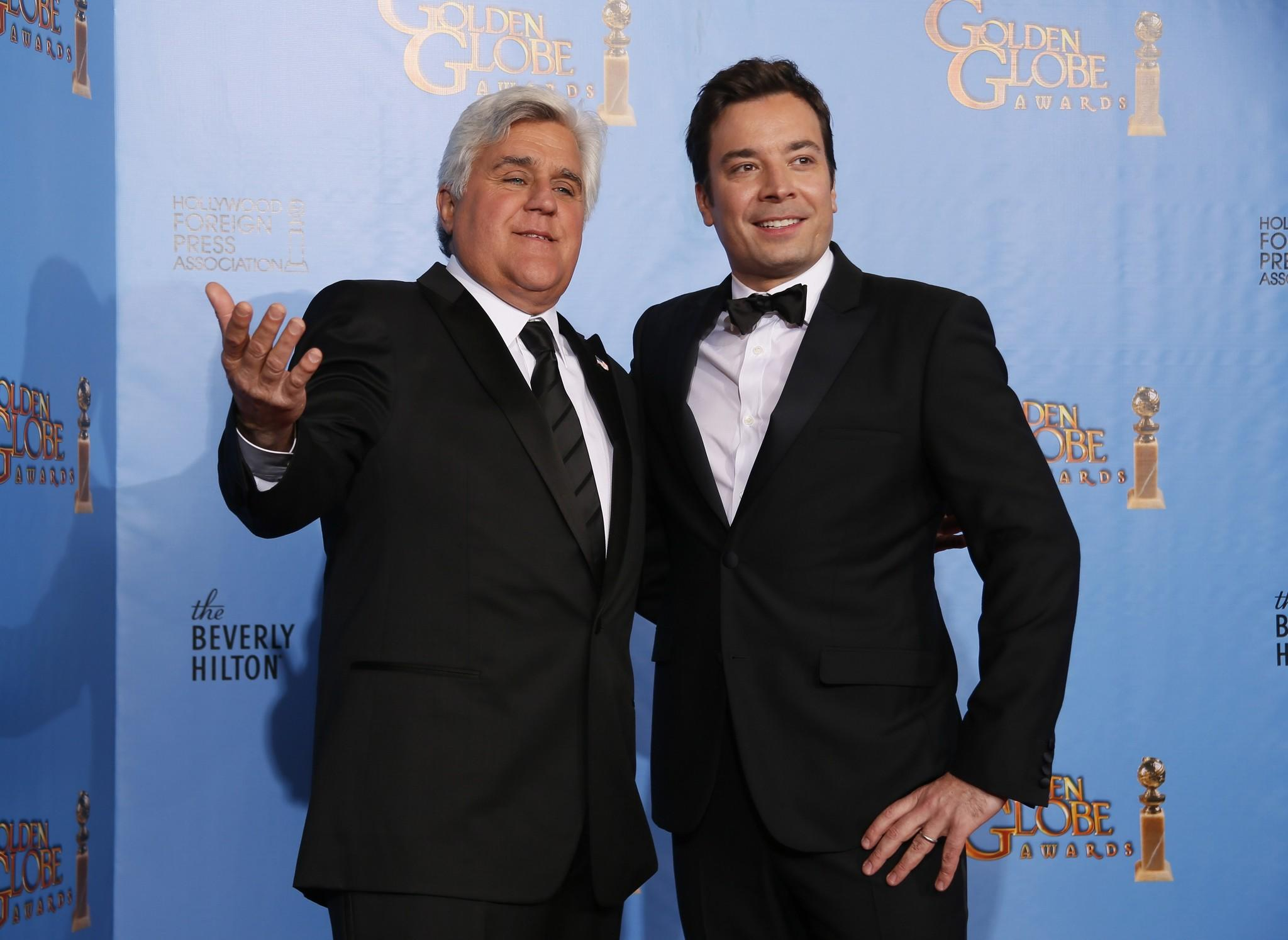 Late night talk show hosts Jay Leno (L) and Jimmy Fallon pose backstage at the 70th annual Golden Globe Awards.