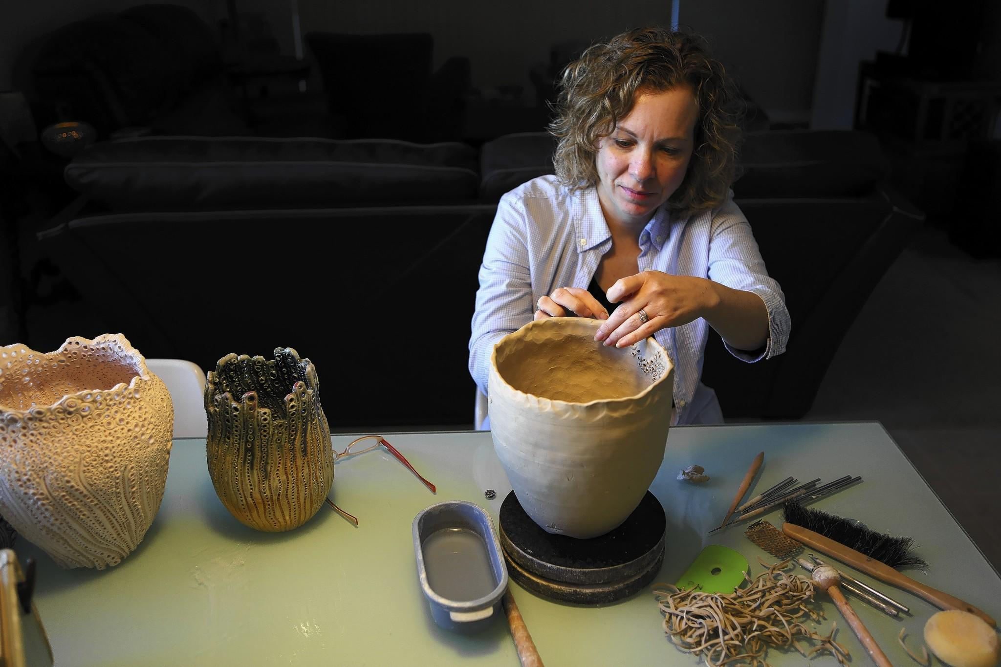 Peggi Nadeau works on a piece on Monday, January 21, 2014. Nadeau's pottery wiill be on display at the Mount Dora Art Festival.