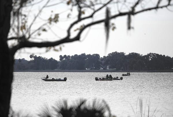 Anglers look for a good spot on Lake Dora, Friday, January 24, 2014, during the first day of the Bass Pro Shops Crappie Masters Tournament on the Harris Chain of Lakes.