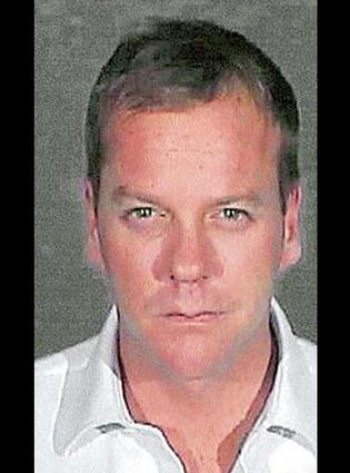 Actor Kiefer Sutherland poses for his mugshot photo at Glendale City Jail on December 5, 2007, in Glendale City, California. Sutherland, 40, reported to the facility to serve a 48-day sentence after pleading guilty to a second drunk driving offense.