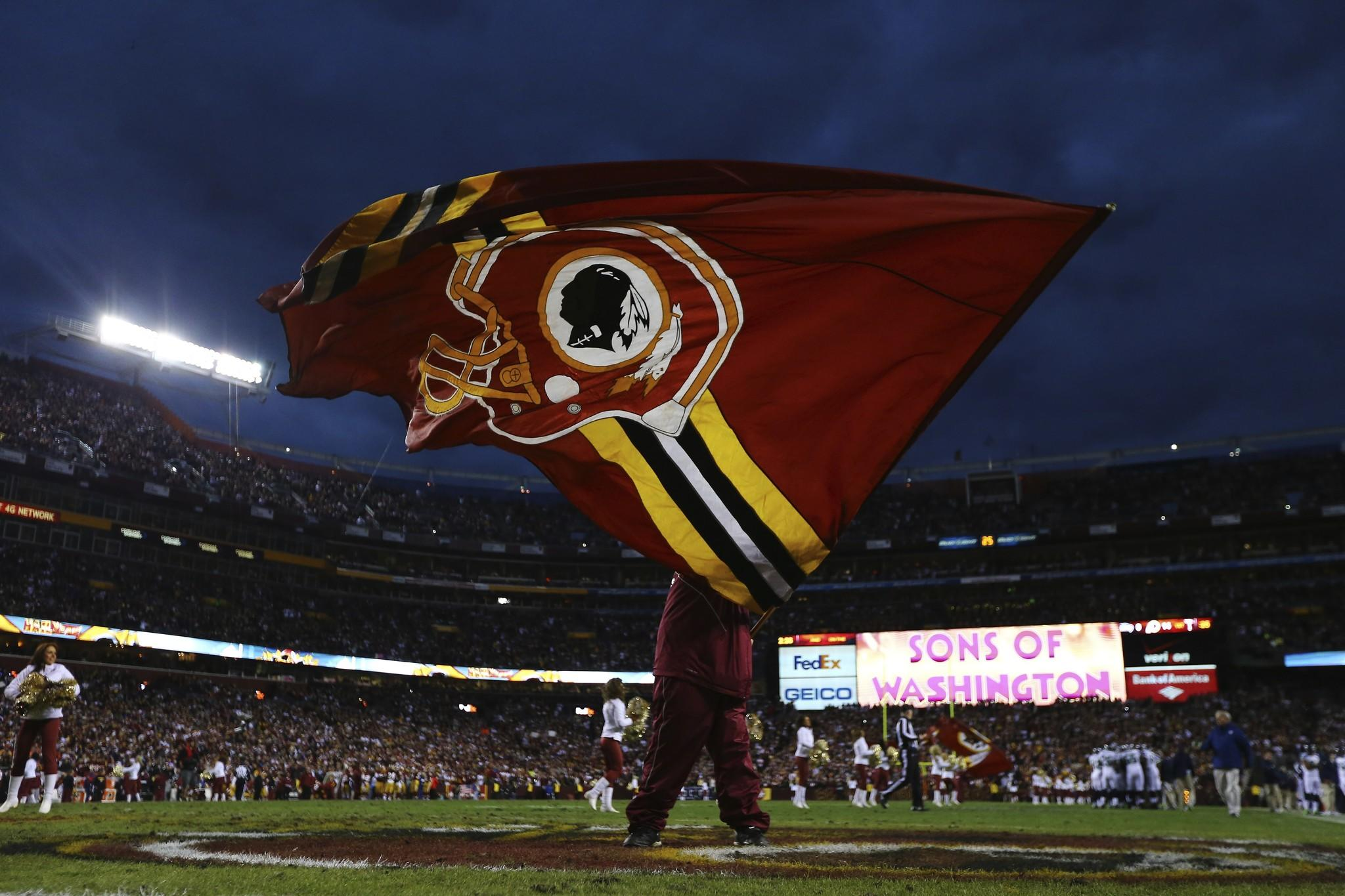 A Washington Redskins flag is waved prior to a game in early 2013.