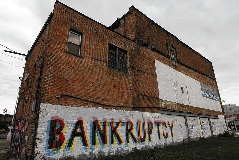 """File photo of the word """"Bankruptcy"""" is painted on the side of a building in Detroit Michigan."""