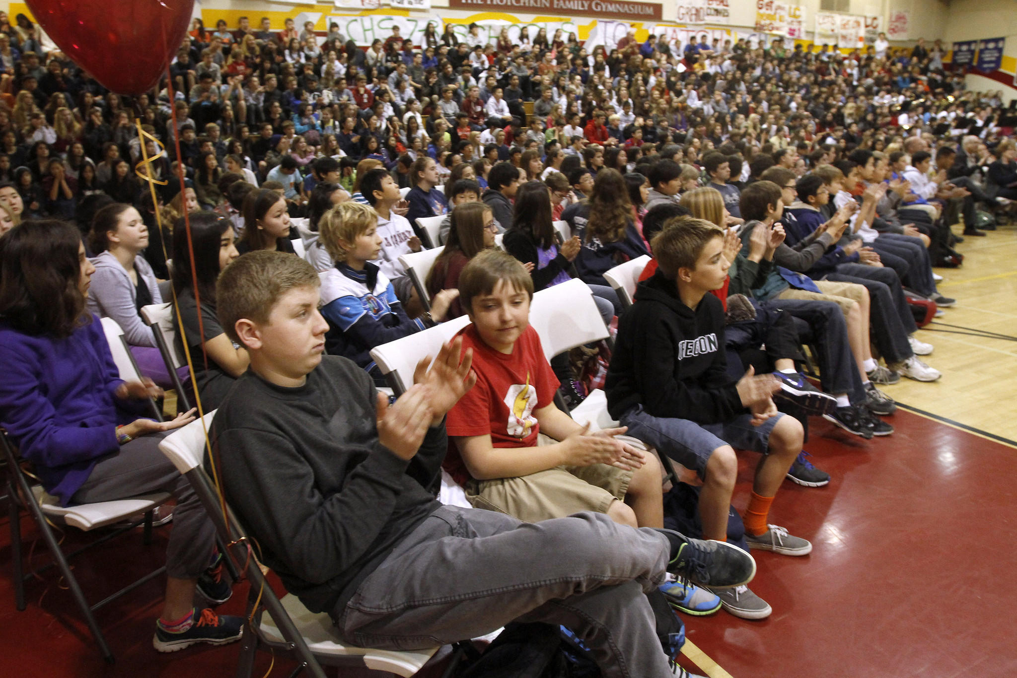 "Middle school students listen to speakers as La Cañada High School 7/8 was named a 2014 ""Schools to Watch"" model middle school, with a banner presented to school representatives at the school's gym in La Cañada Flintridge on Friday, Jan. 31, 2014."