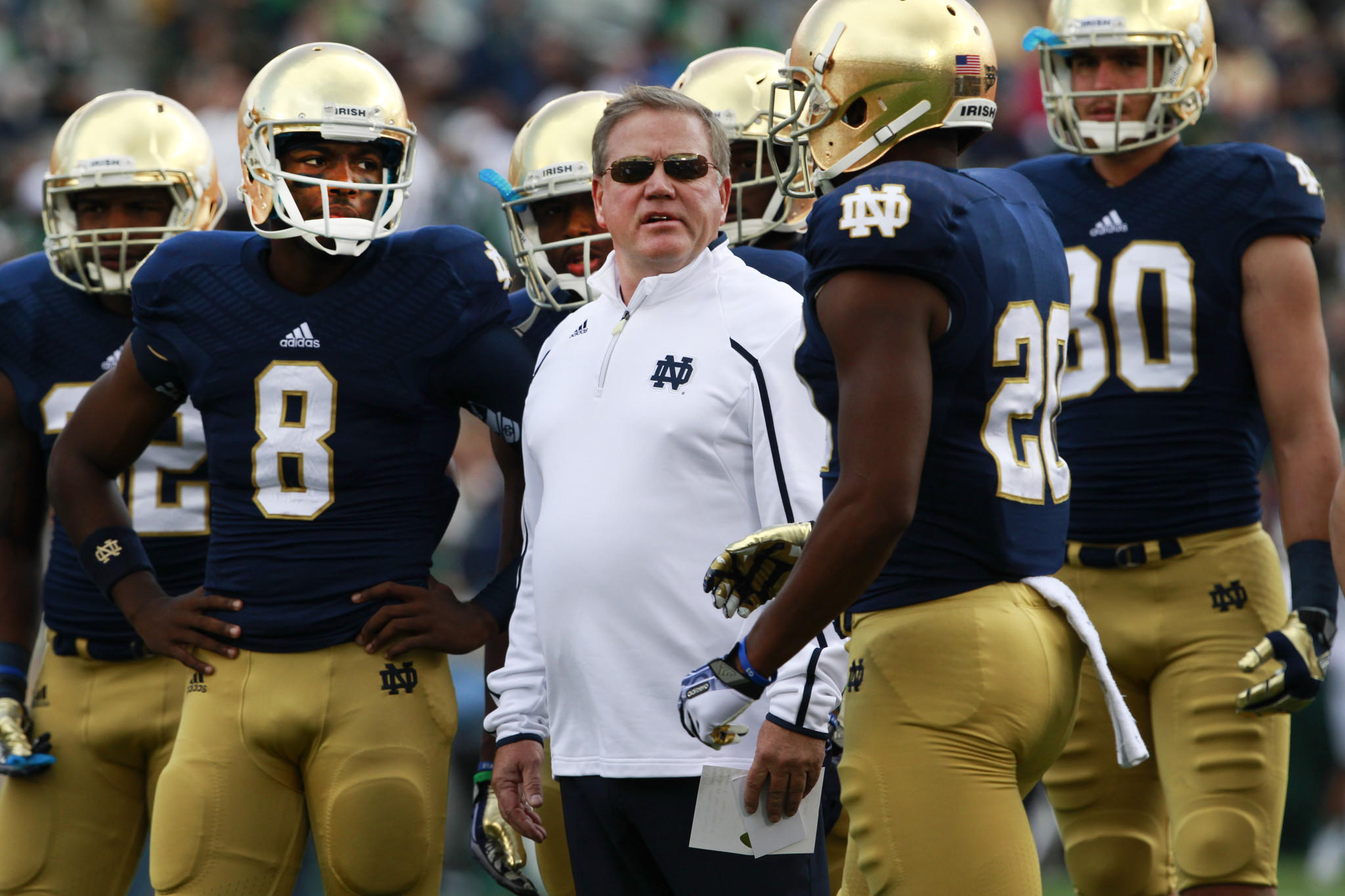 Notre Dame Fighting Irish coach Brian Kelly, with his players, before the start of their game against the Michigan State Spartans, at Notre Dame Stadium, in South Bend, Ind., on Saturday Sept. 21, 2013.