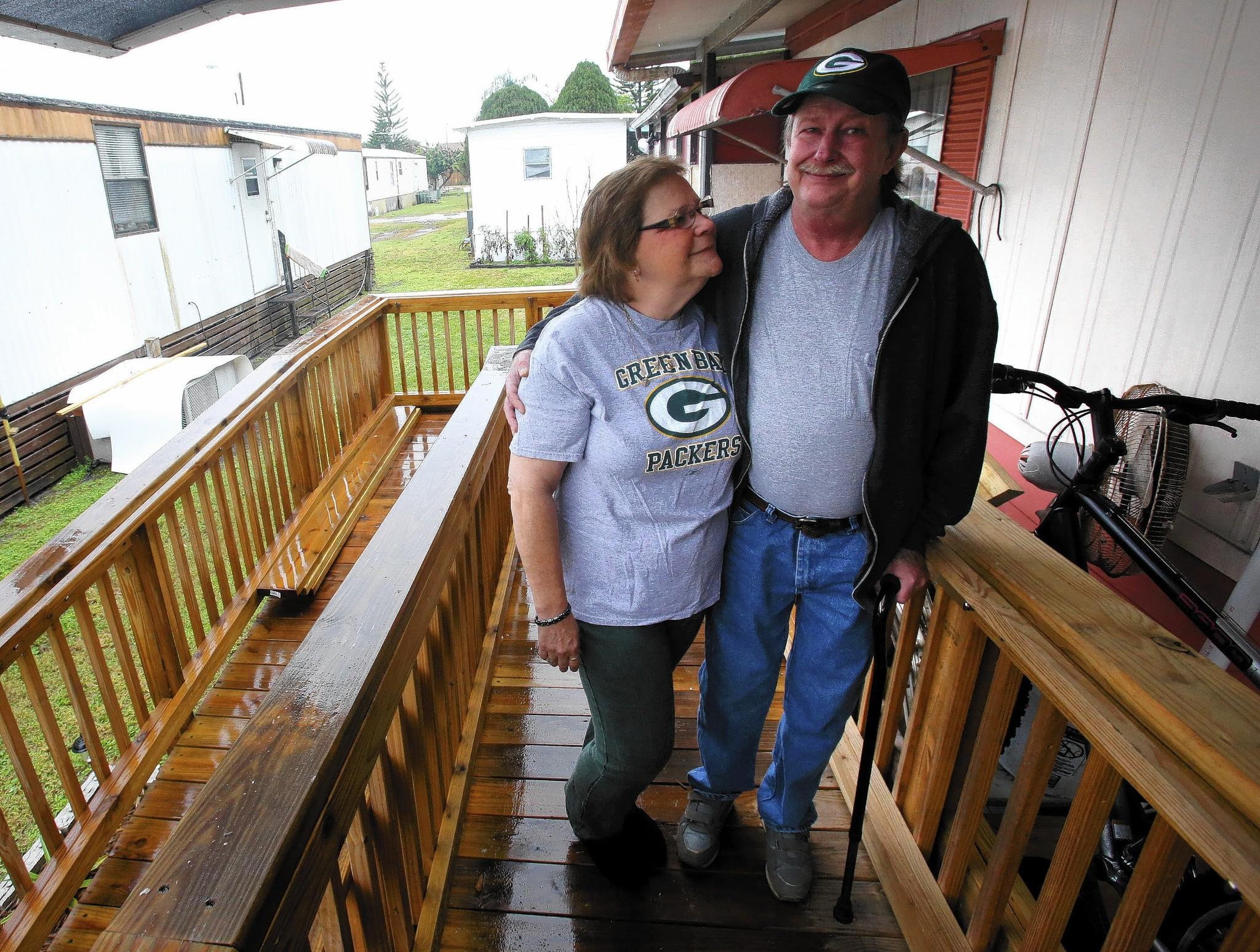 Dale and Carole Parker stand, Friday, Jan. 31, 2014, on the 30-foot ramp built last year by Rampage volunteers.