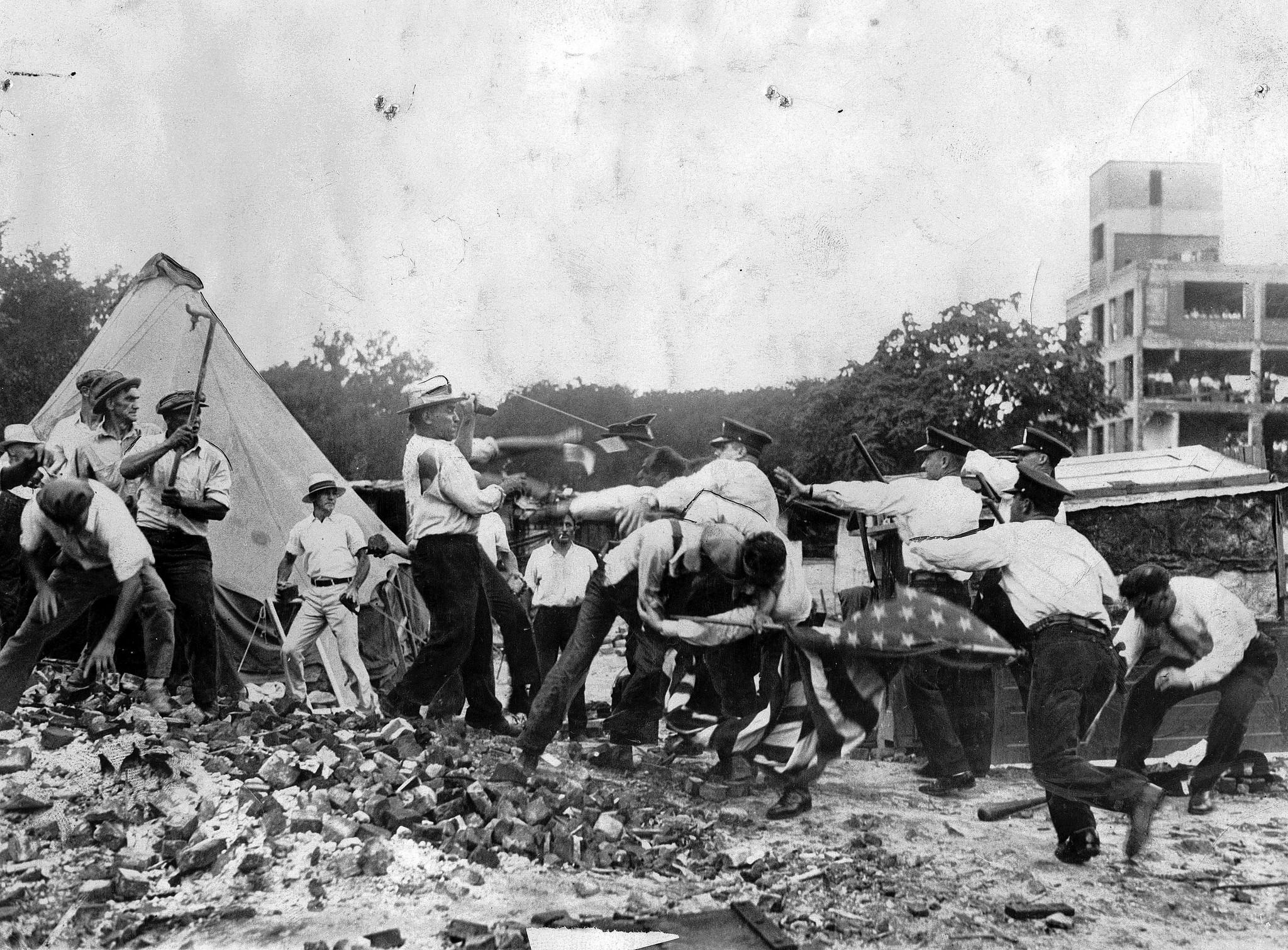 World War I veterans throw bricks and stones at charging police officers when the police tried to evict them from camping on government property in Washington, D.C., on July 28, 1932.