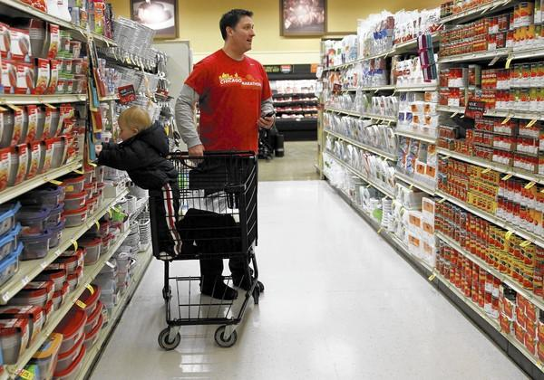 David Wallach, a stay-at-home dad who lives in Northfield, makes a trip to the grocery store with his son Charlie, 1.