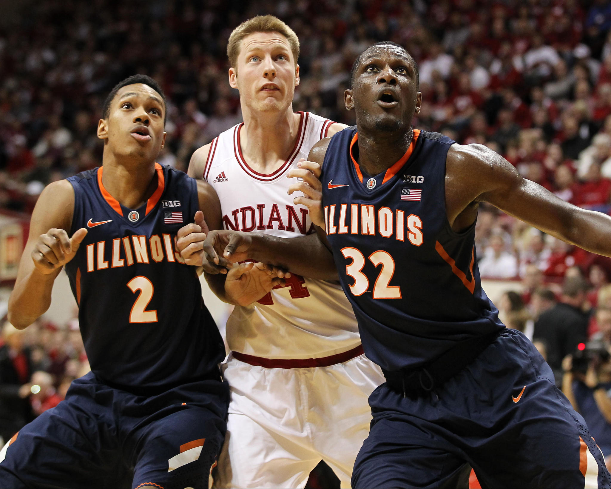 Illinois Fighting Illini guard Joseph Bertrand (2), Indiana Hoosiers forward Jeff Howard (24), and Illini forward/center Nnanna Egwu (32) battle for position during the first half at Assembly Hall.