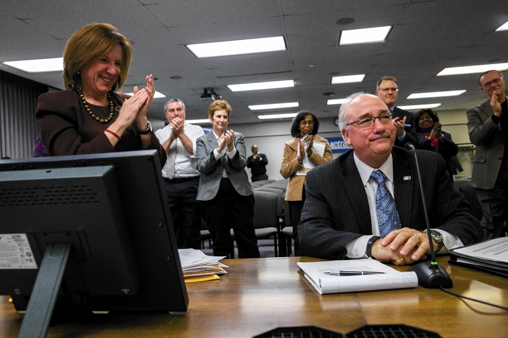 Don Orseno is applauded by staff members after being named Metra's executive director Friday.