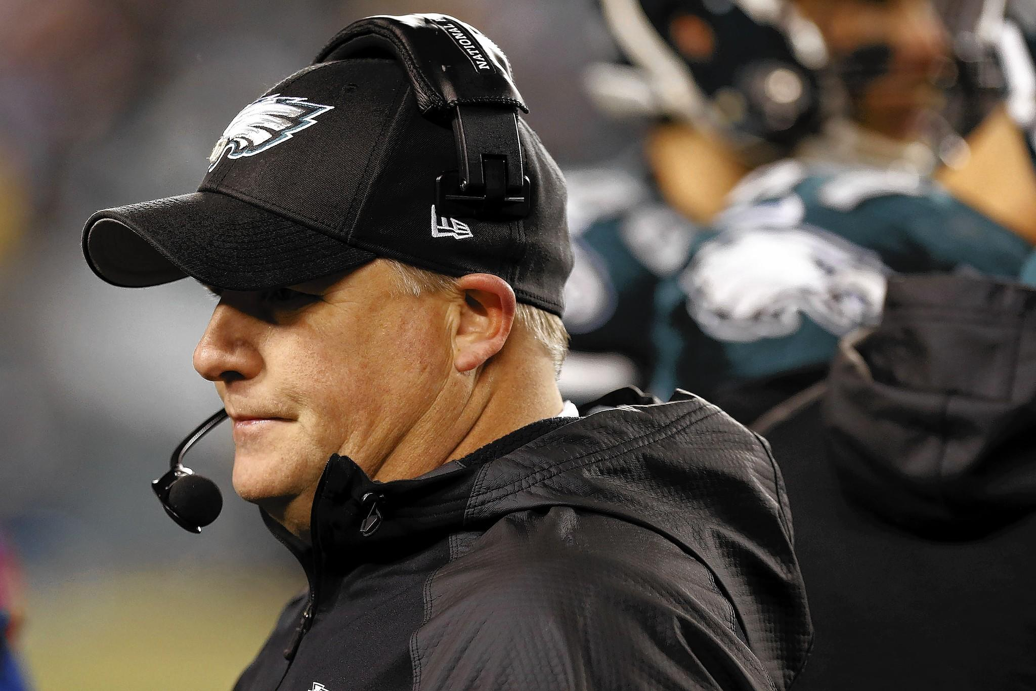 Jan 4, 2014; Philadelphia, PA, USA; Philadelphia Eagles head coach Chip Kelly stands on the sidelines against the New Orleans Saints in he second quarter during the 2013 NFC wild card playoff football game at Lincoln Financial Field.