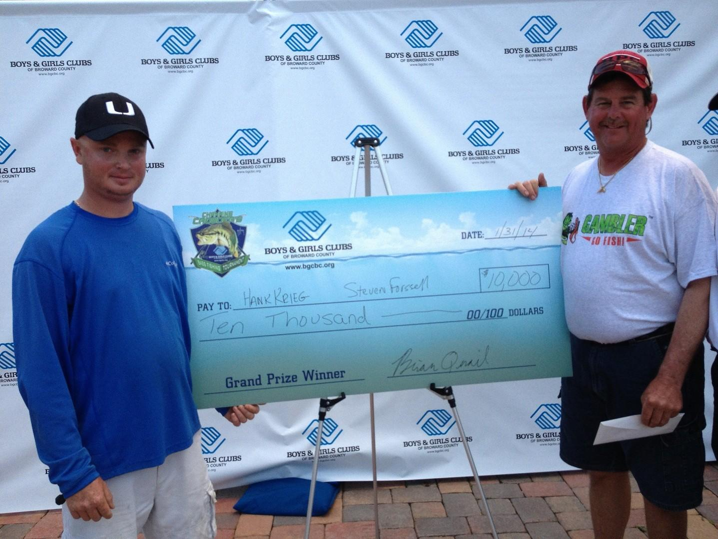Steven Forssell, left, and Hank Krieg with their $10,000 check for winning the Channing Crowder's Bass Fishing Tournament.