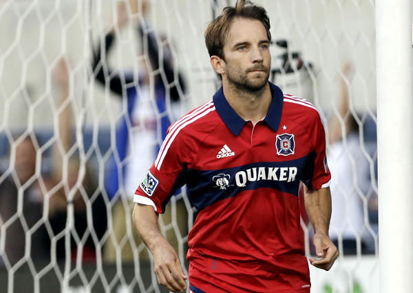 Chicago Fire midfielder Mike Magee heads away from the goal after scoring on a penalty kick in an MLS game against the Colorado Rapids last season.