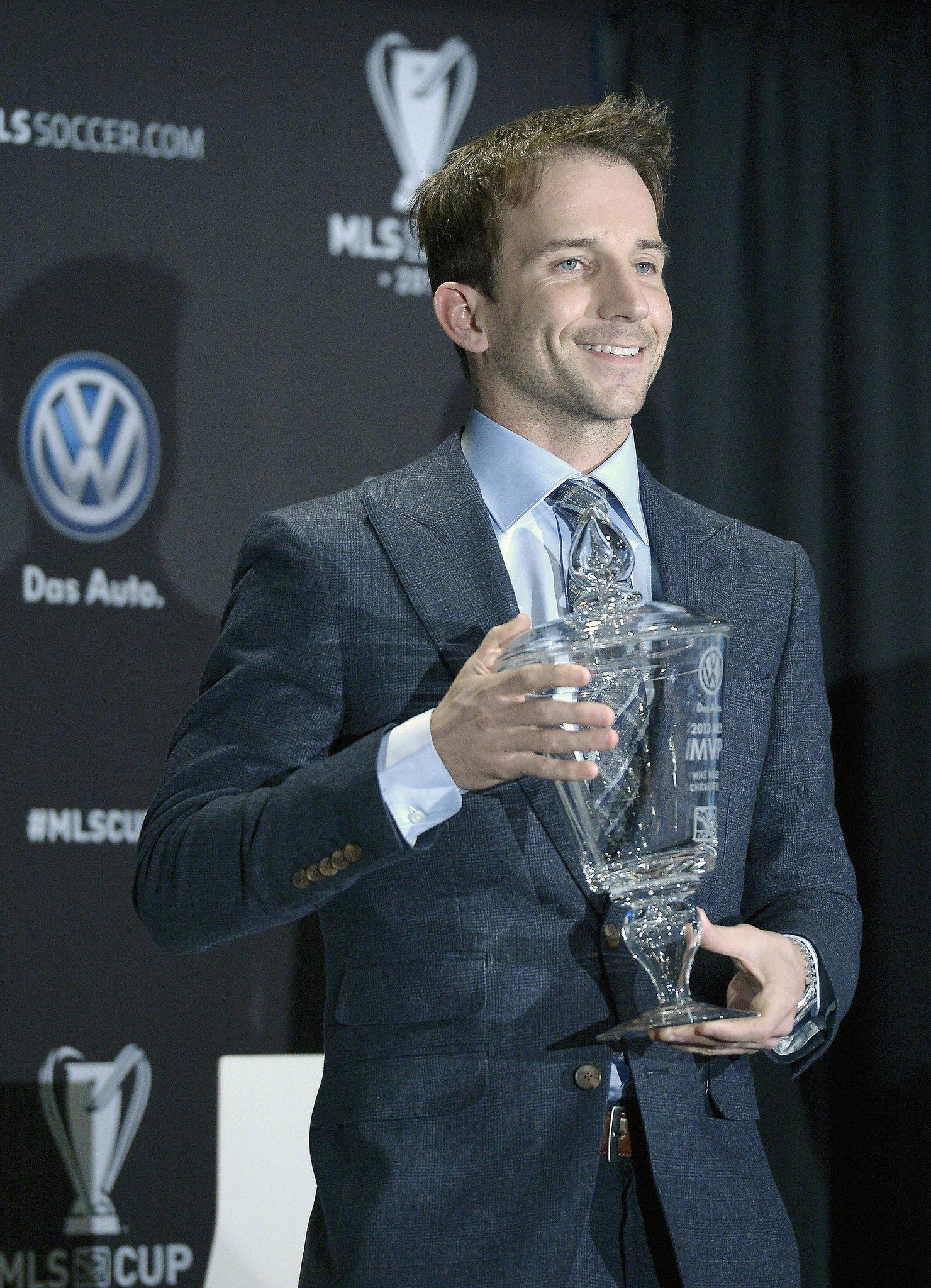 Major League Soccers most valuable player, Mike Magee of the Chicago Fire, holds the MVP trophy during Thursday's MLS Championship game press conference announcing his award in Kansas City, Mo., Dec. 5, 2013.