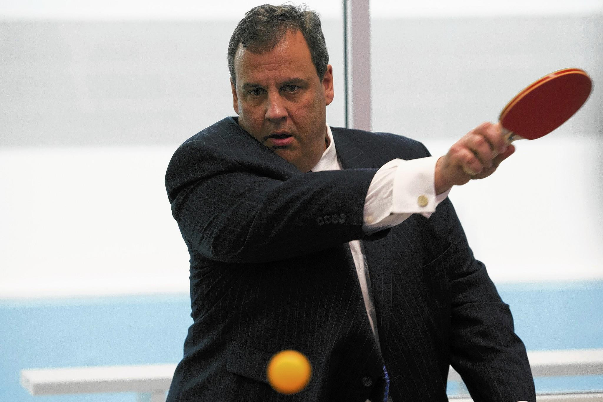 New Jersey Gov. Chris Christie tries his hand at table tennis after a news conference in Newark on Monday.