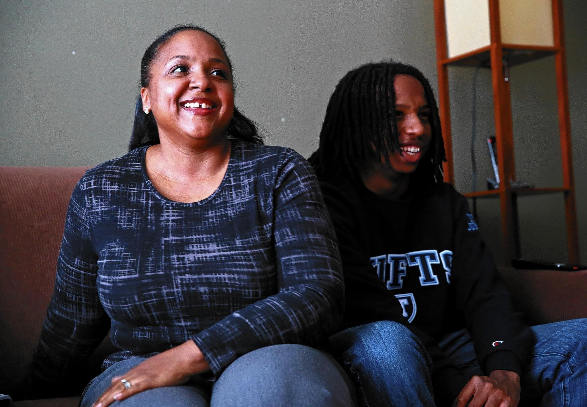 "Jocelyn Dorsey, shown with her son Khalil, says: ""It is very depressing to know that unless my son gets a lot of scholarship money, he will be faced with trying to get loans, and I don't want that for him. No one should have to face $160,000 of student debt."""