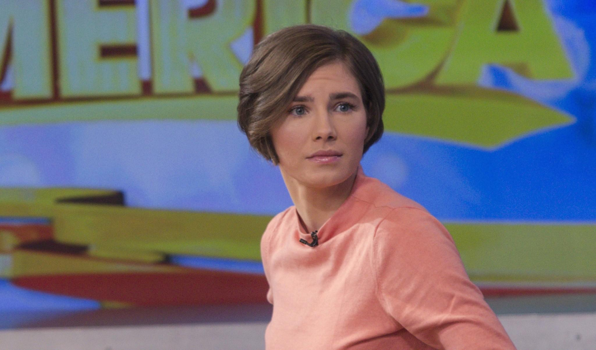 "Amanda Knox reacts while being interviewed on the set of ABC's ""Good Morning America"" in New York January 31, 2014. Knox vowed on Friday to fight her second conviction for the murder of British student Meredith Kercher in 2007 while the two were students together in the Italian university town of Perugia."