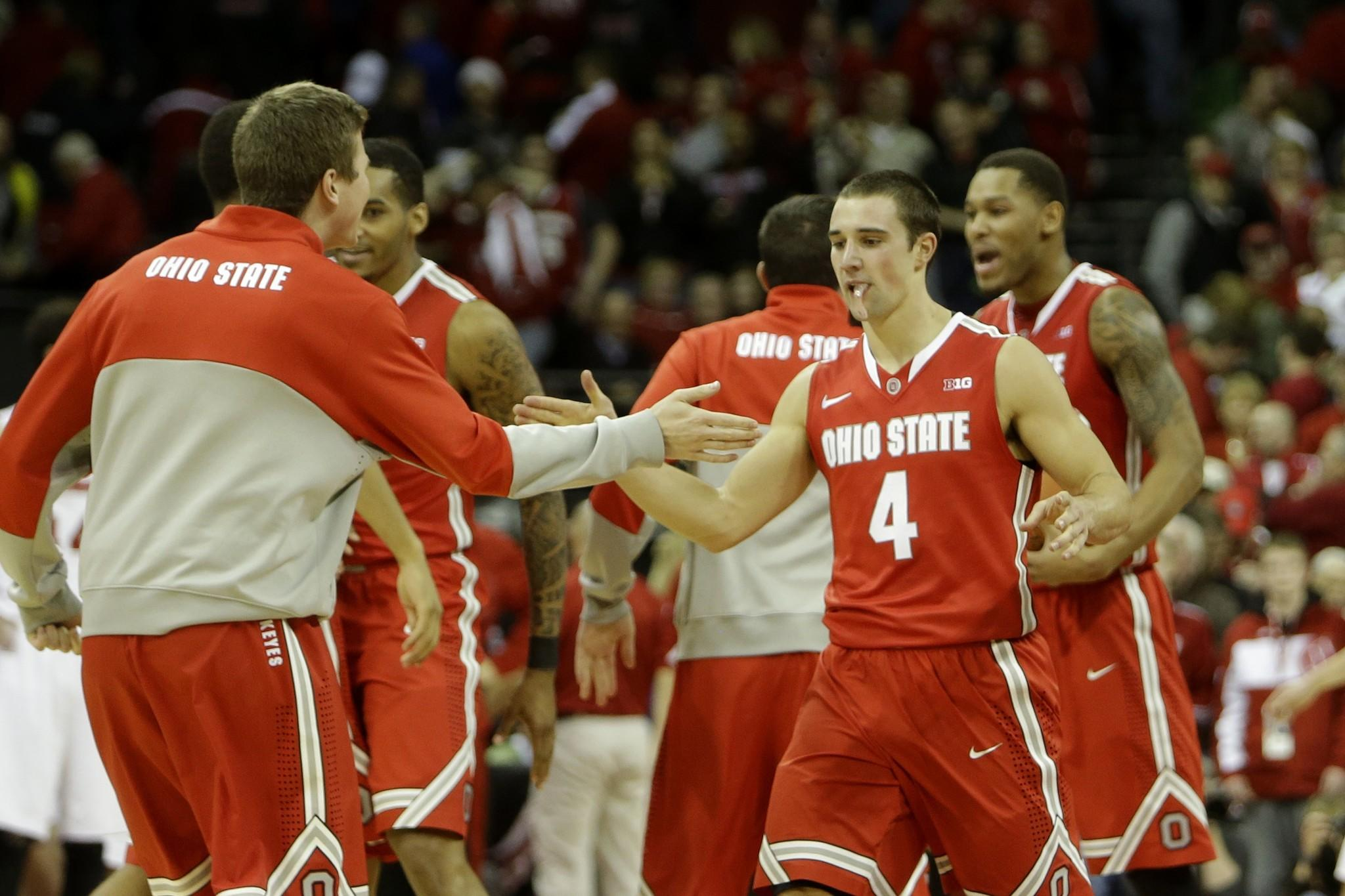 Aaron Craft (4) of Ohio State celebrates after the win over Wisconsin.