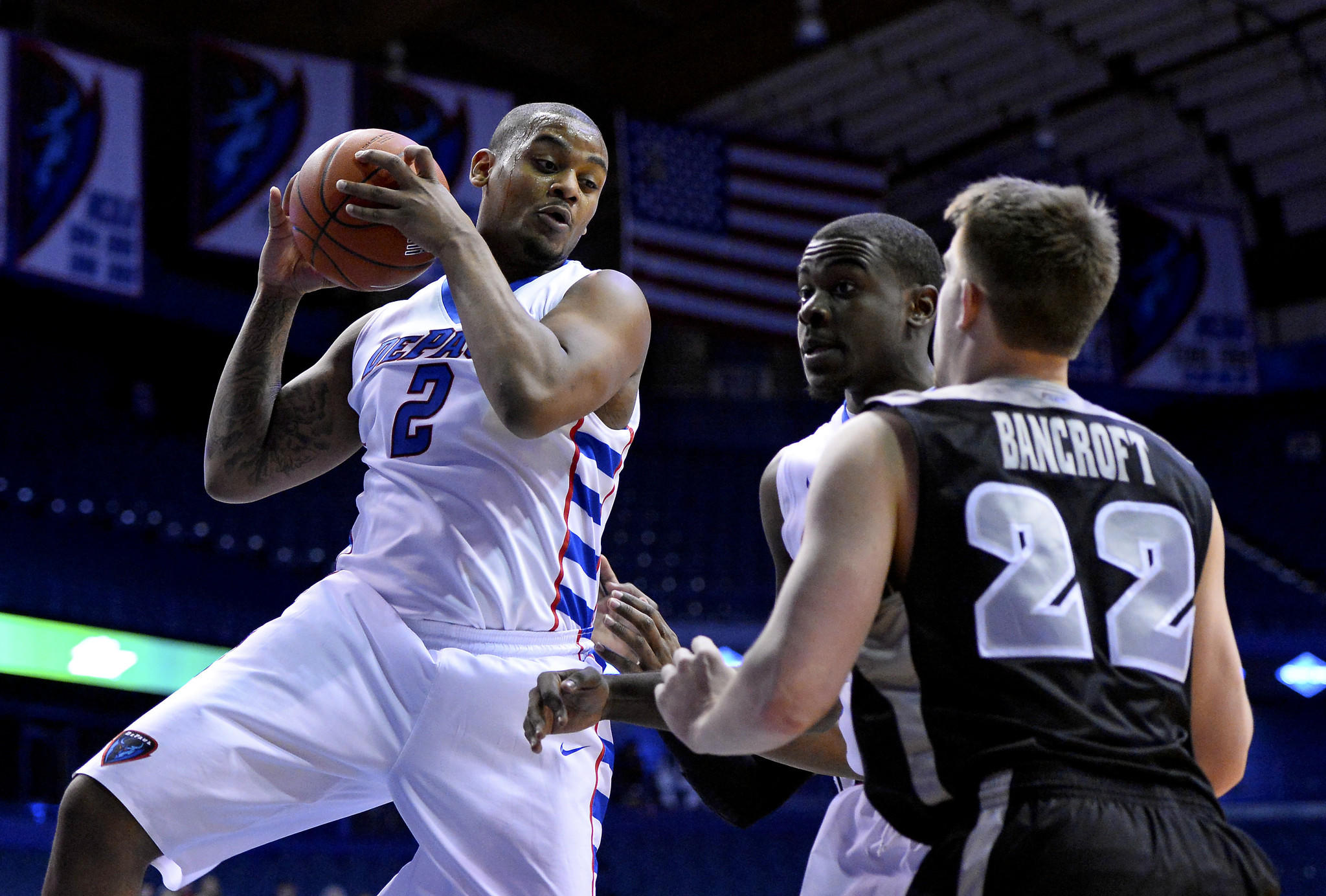 DePaul center Tommy Hamilton IV grabs a rebound against Providence guard Ted Bancroft.