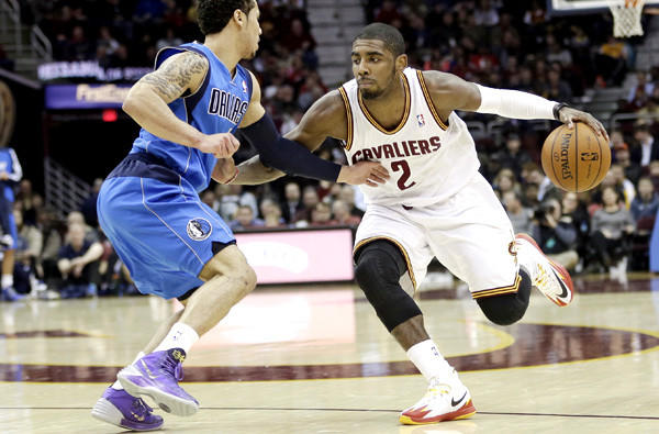 Cavaliers point guard Kyrie Irving drives against Mavericks point guard Shane Larkin during a game earlier this season.