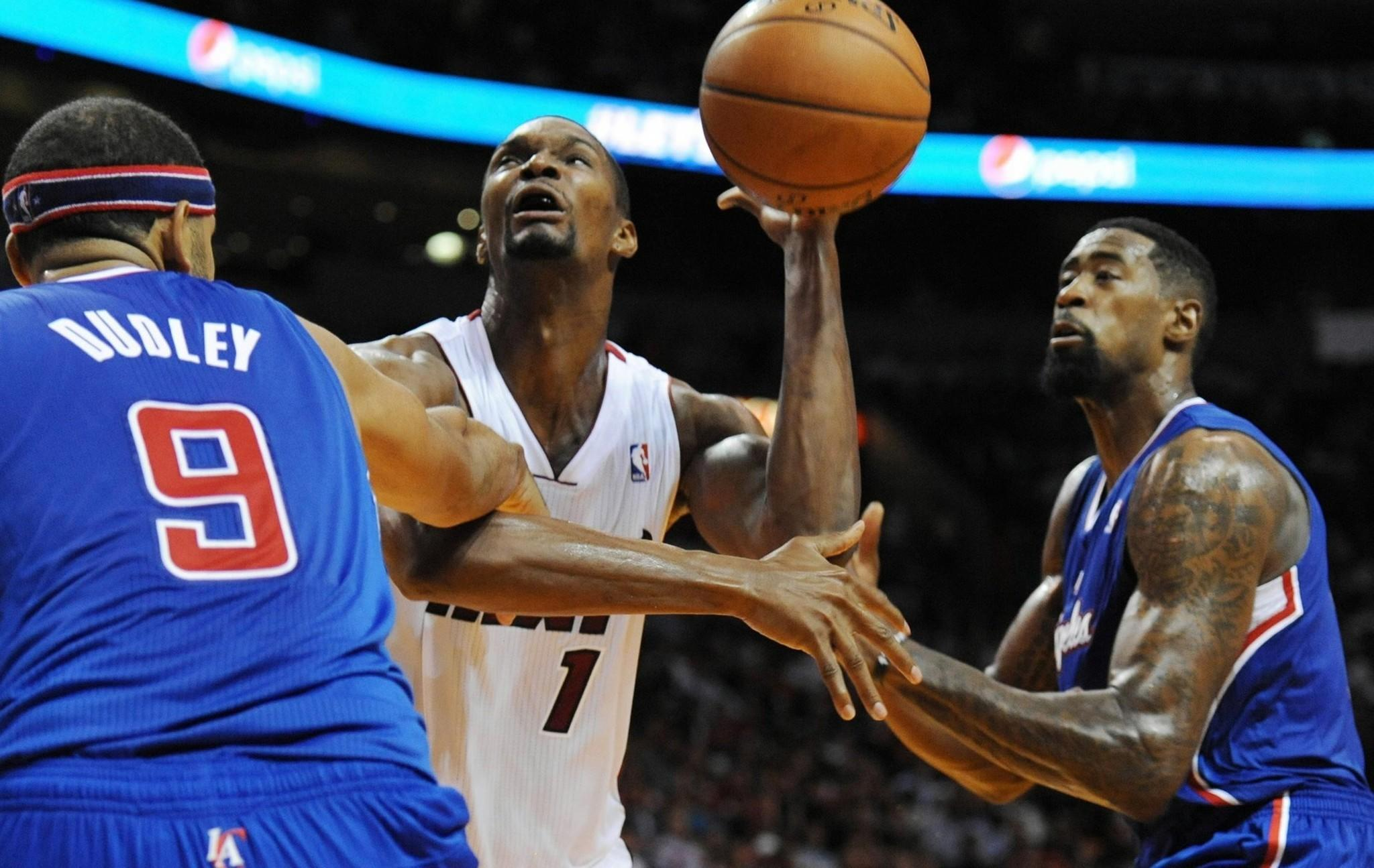 Heat power forward Chris Bosh looks to score inside against Clippers forward Jared Dudley and center DeAndre Jordan during a game earlier this season at Staples Center.