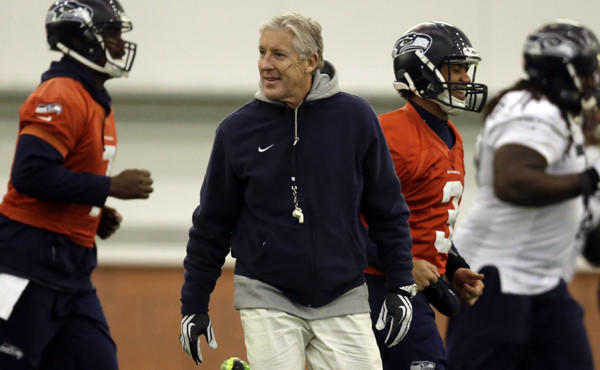 Seattle Seahawks Coach Pete Carroll watches as players warm up during a team practice session Thursday. Carroll may be the second-oldest coach in the NFL, but he doesn't act like it.