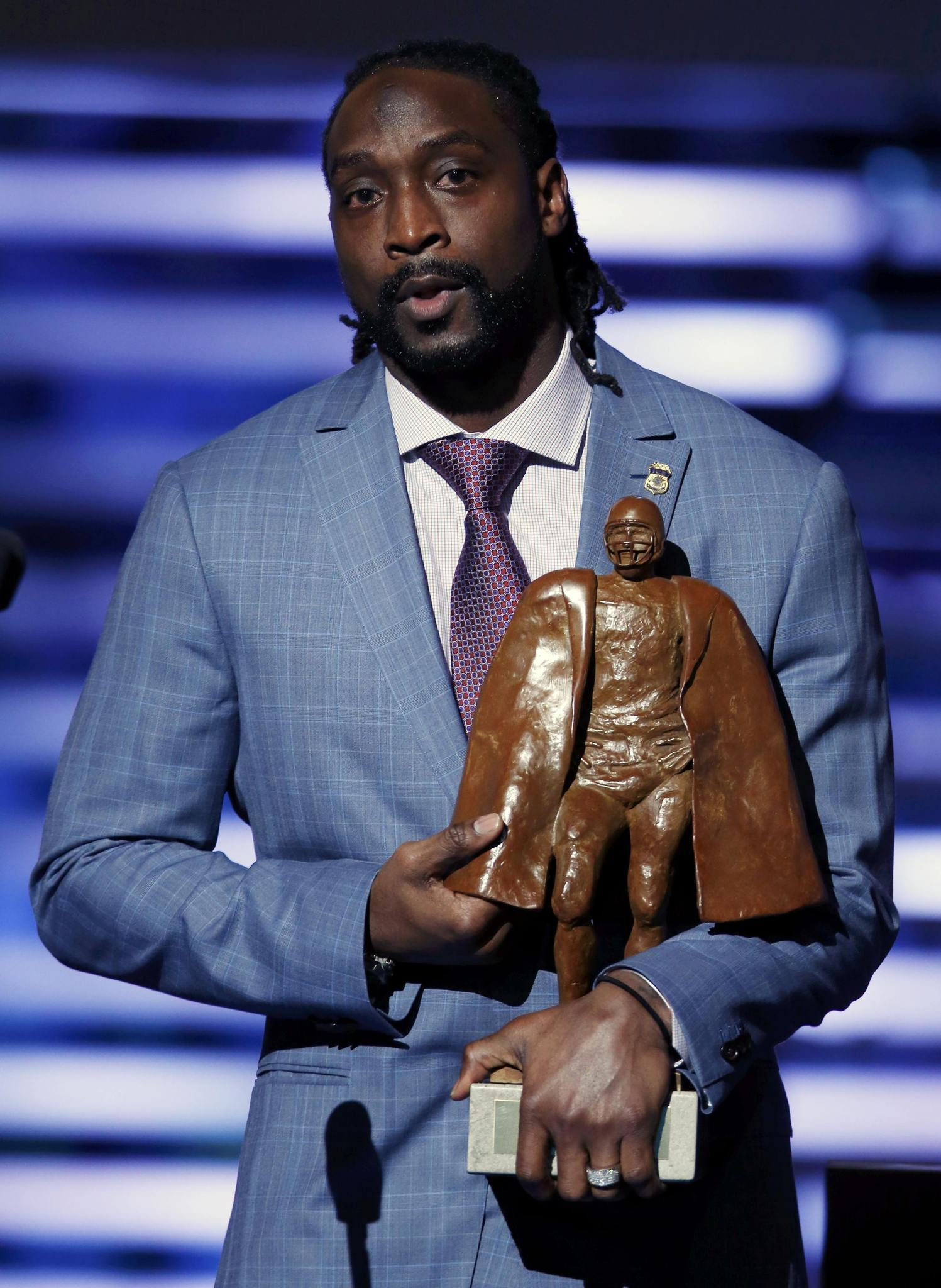 Chicago Bears Charles Tillman speaks after accepting the Walter Payton NFL Man of the Year award during the NFL Honors award show in New York February 1, 2014.