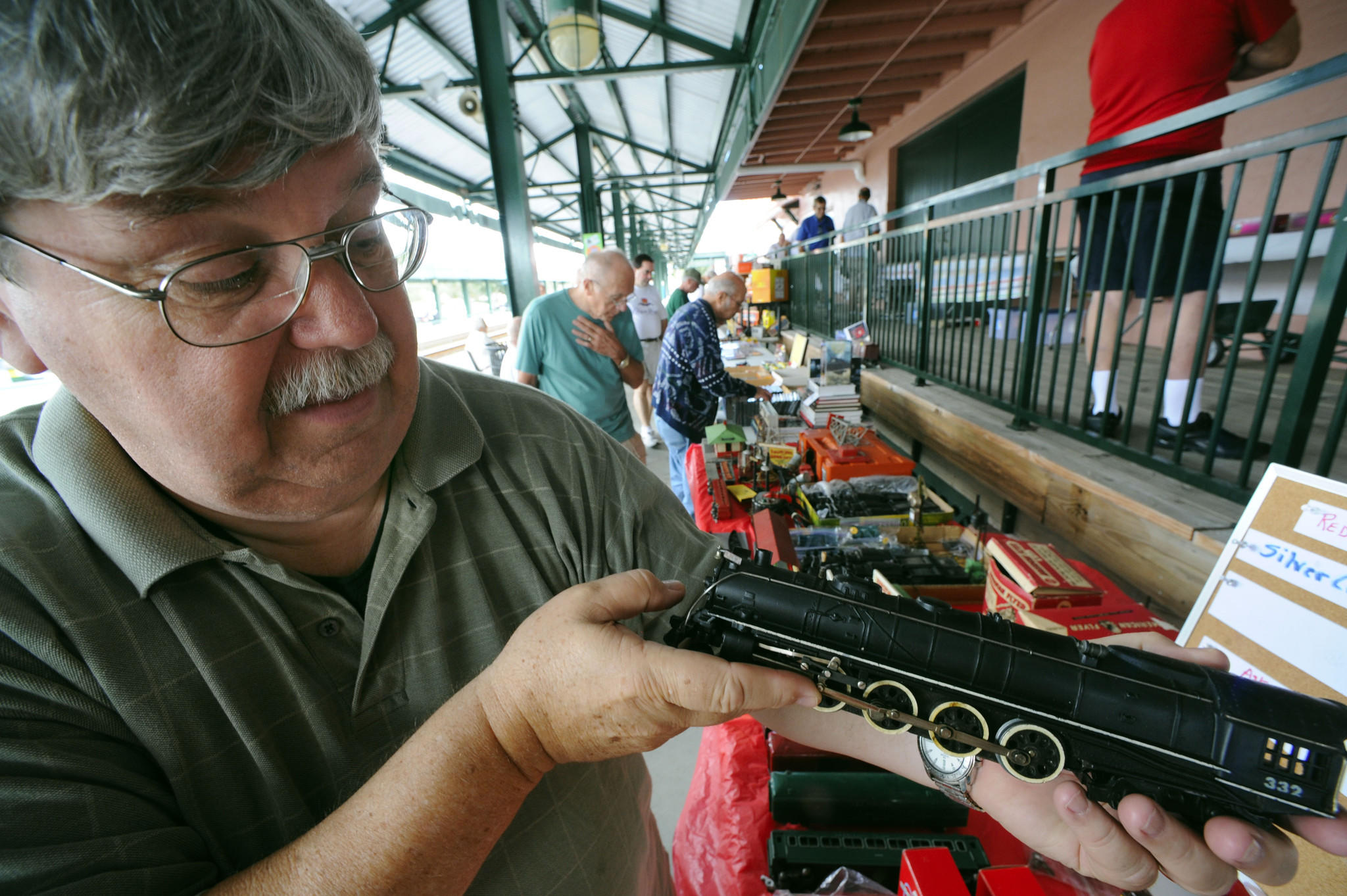 John Childrey shows displays his prized American Flyer 332 Challenger steam locomotive model at Saturday's South Florida Railway Museum swap meet held at the train station in Deerfield Beach.