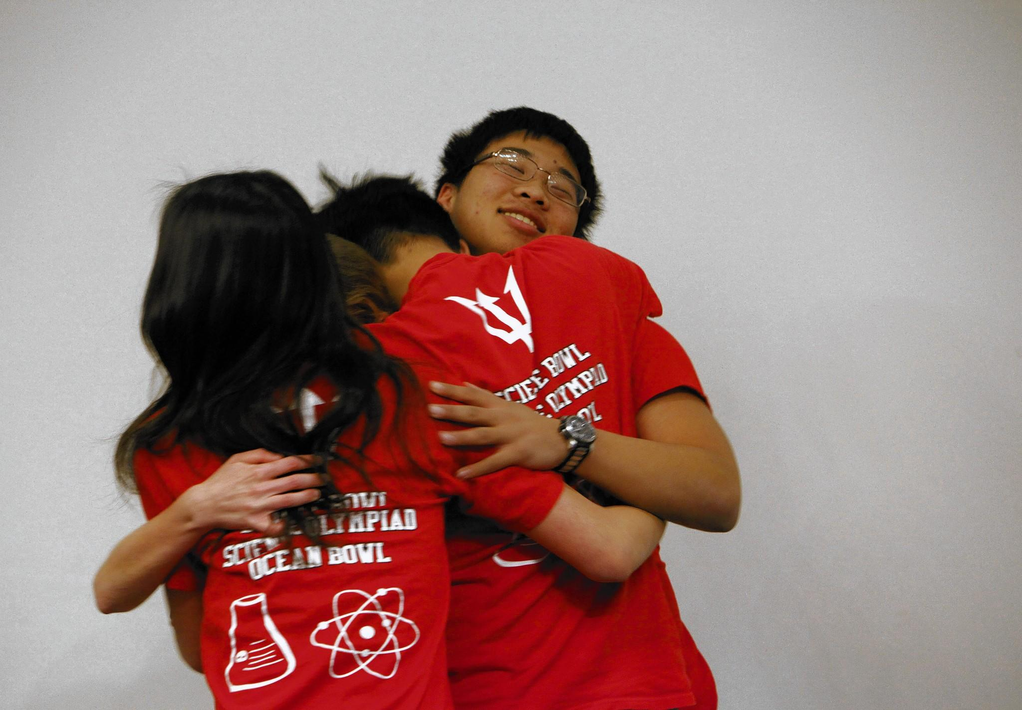 Members of the Palos Verdes High School team share a group hug after winning a match during the Regional Science Bowl at NASA's Jet Propulsion Laboratory. Left to right are Jessica Chen, Zoe Caron, Royce Chen and Kevin Jiao.