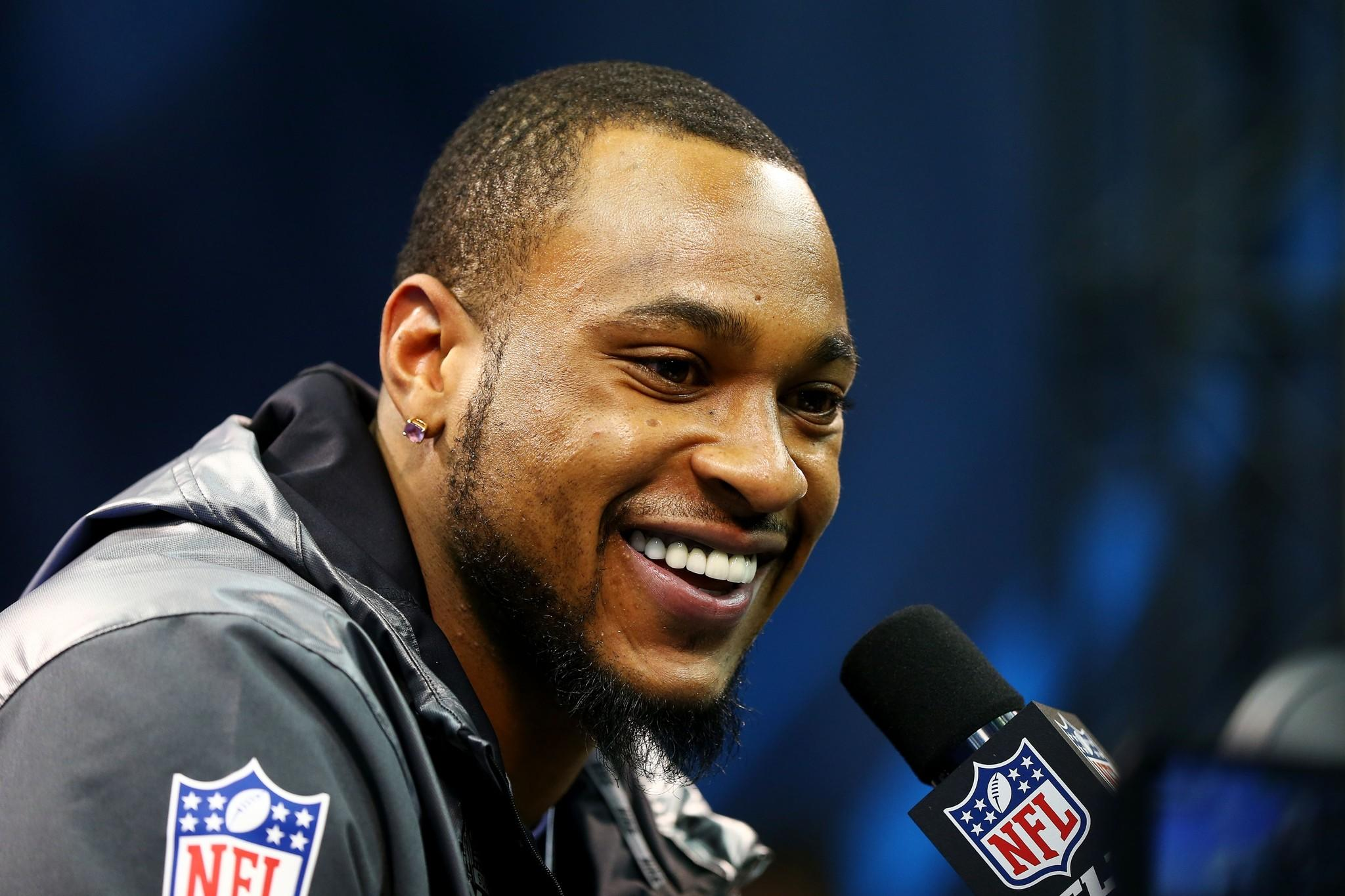 Wide receiver Percy Harvin #11 of the Seattle Seahawks speaks to the media during Super Bowl XLVIII Media Day at the Prudential Center on January 28, 2014 in Newark, New Jersey. Super Bowl XLVIII will be played between the Seattle Seahawks and the Denver Broncos on February 2.