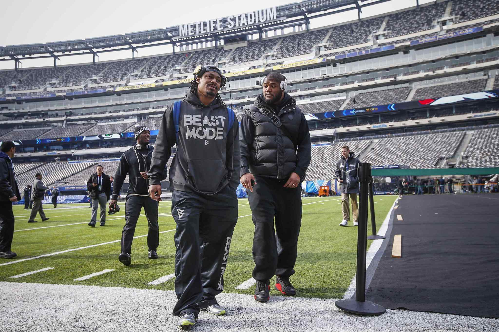 Seattle Seahawks running back Marshawn Lynch (C) walks off the field at the MetLife Stadium during their NFL Super Bowl XLVIII walk-through in East Rutherford, New Jersey February 1, 2014. The Seahawks will play against the Denver Broncos in the game on February 2.