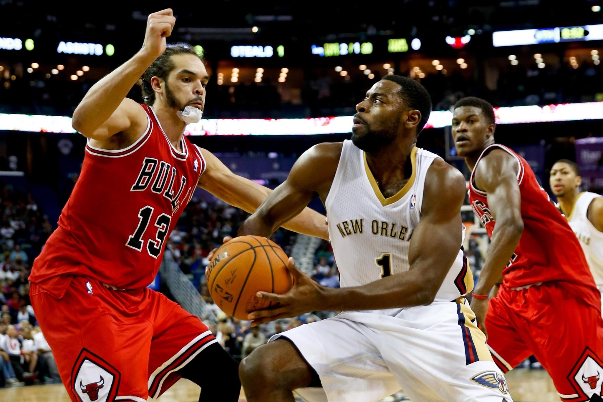 New Orleans Pelicans point guard Tyreke Evans (1) drives past Chicago Bulls center Joakim Noah (13) during the second half of a game at the New Orleans Arena. The Pelicans defeated the Bulls 88-79.