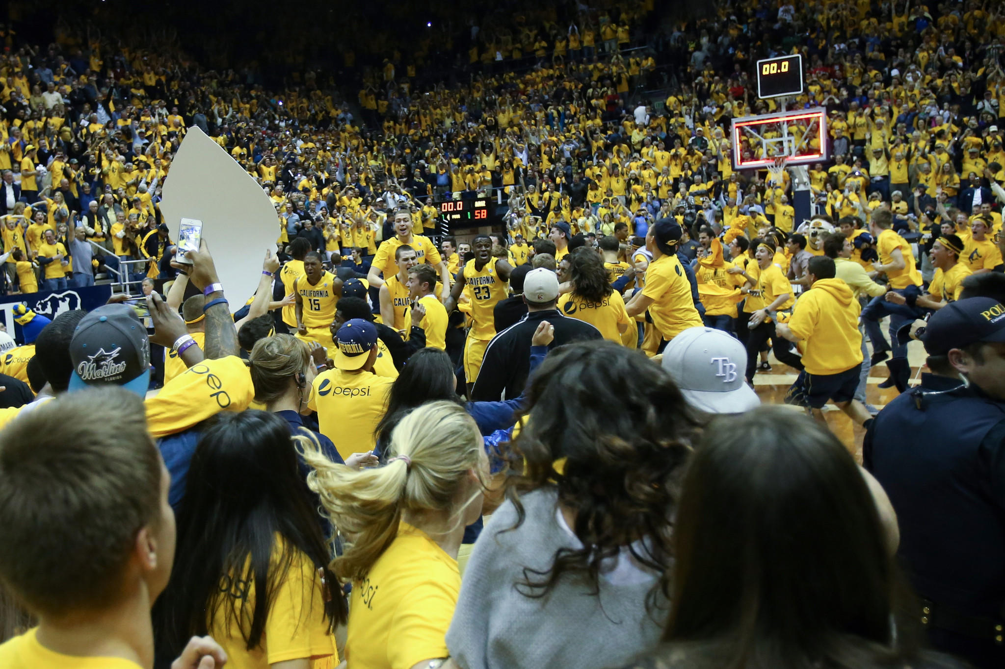 California fans rush the court to celebrate with players.