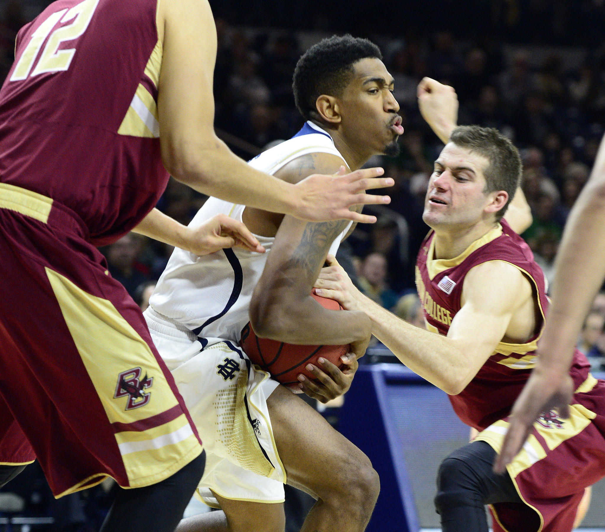 Notre Dame guard Eric Atkins (0) attempts to keep the ball away from Boston College guard Joe Rahon.