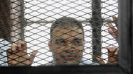 Egyptian court acquits Al Jazeera journalist, 61 others